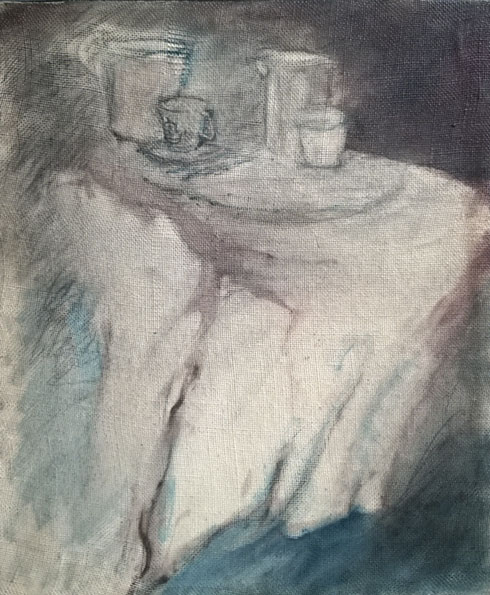 The blue cup on the white tablecloth